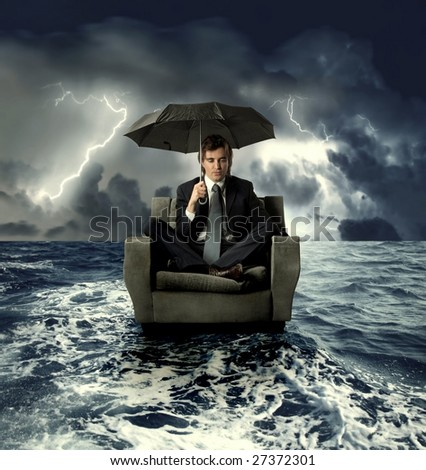 businessman on an armchair lost in the sea - stock photo