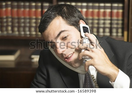 Businessman on cell phone in office. Horizontally framed photo. - stock photo