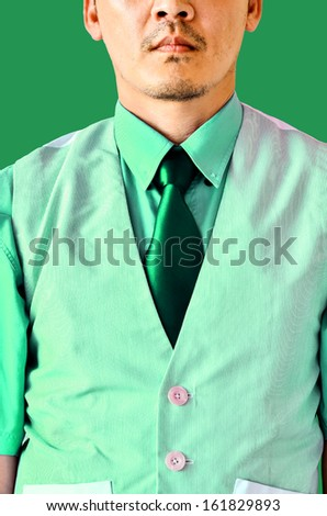 businessman on green shirt - stock photo