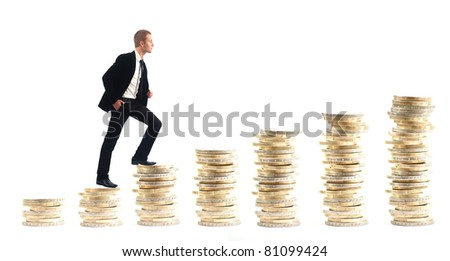 Businessman on money stairs isolated on white background - stock photo