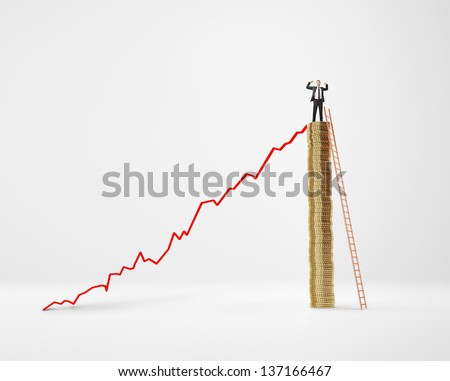 Businessman on pole of coins and diagram - stock photo