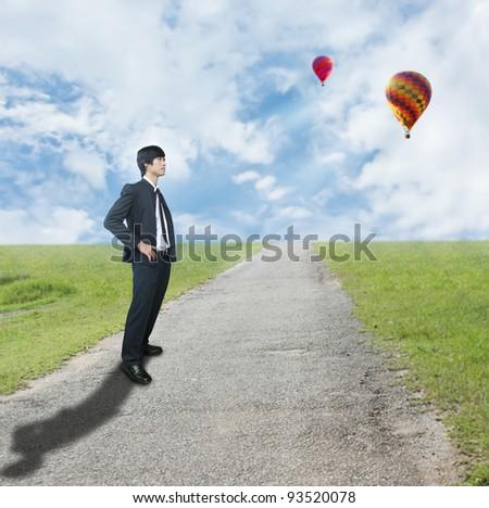 Businessman on rough way - stock photo