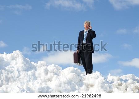Businessman On  Snow Hill - stock photo