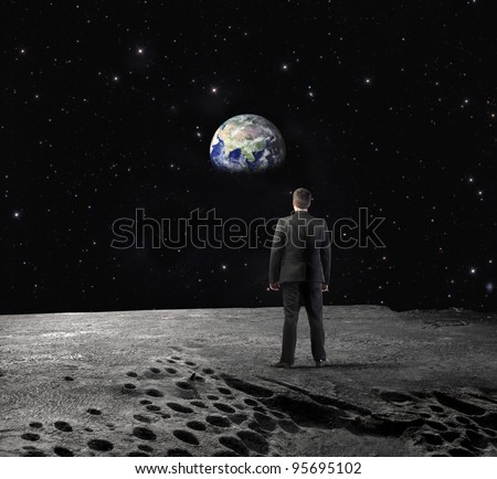 "Businessman on the Moon observing the Earth in the background ""Elements of this image furnished by NASA"" - stock photo"