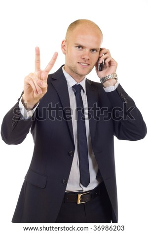 businessman on the phone making his victory sign - stock photo