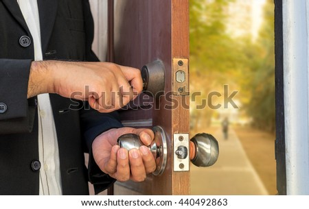 businessman open the door by key to travel on the way - can use to display or montage on product or concept about find out the real life - stock photo