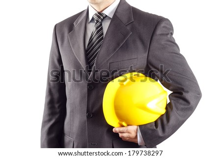 businessman or engineer holding a helmet under his arm against white background - stock photo