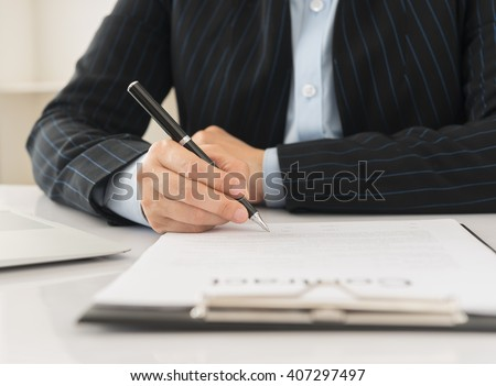 Businessman or lawyer signing  contract. Concept of business agreement details. - stock photo