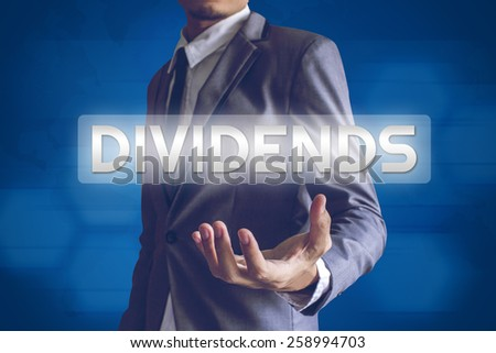 Businessman or Salaryman with Dividends text modern interface concept. - stock photo