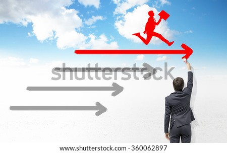 businessman painting three horizontal arrows with a brush, a red silhouette of a running man with a folder on the top one, blue sky with clouds at the background. Back view. Concept of setting a goal. - stock photo