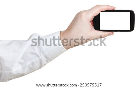businessman photoshoots by smart phone with cut out screen isolated on white background - stock photo
