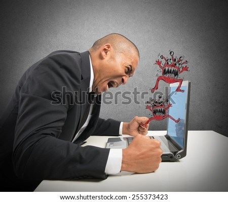 Businessman pissed because of his computer crashed - stock photo