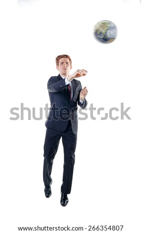 Businessman, playing basketball with globe. - stock photo