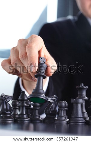 businessman playing chess game - stock photo