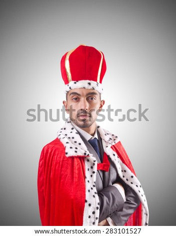 Businessman playing king isolated on white - stock photo
