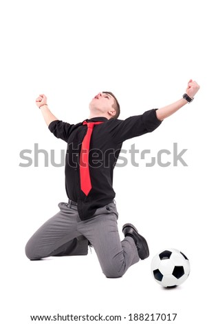 Businessman playing soccer isolated in white - stock photo
