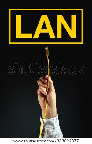 Businessman plugging LAN cable to connect to local area network, business solution. - stock photo