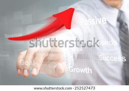 Businessman pointing a rising arrow, representing business growth. - stock photo