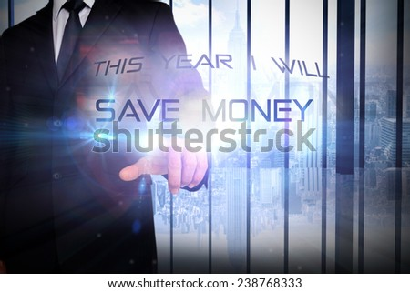 Businessman pointing against room with large window looking on city - stock photo