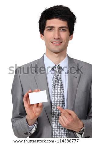 Businessman pointing at blank card - stock photo