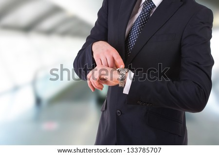 Businessman pointing at his wristwatch. - stock photo