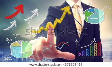 Businessman pointing at rising arrows and graph cartoon - stock photo