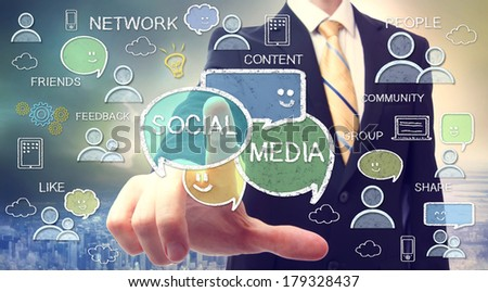 Businessman pointing at social media texts and cartoon - stock photo