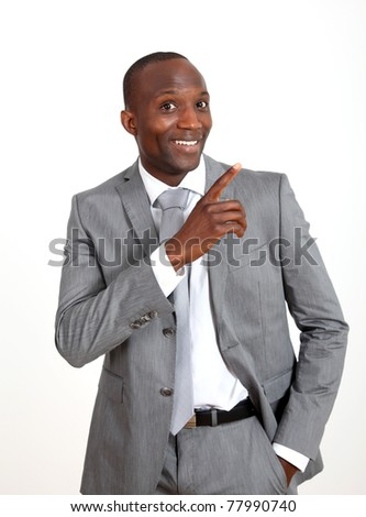 Businessman pointing at something on white background - stock photo