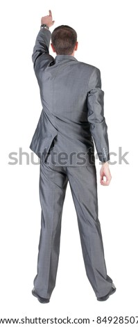 Businessman pointing at wall. rear view. Isolated over white . - stock photo
