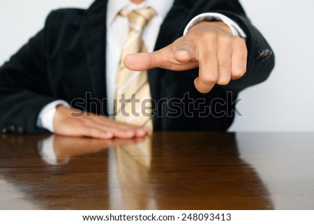 """Businessman pointing at you! Pointing finger """"Wanted!!"""" - stock photo"""