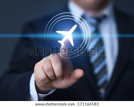 Businessman pointing finger to select a flight by pressing a touch screen airplane button - stock photo