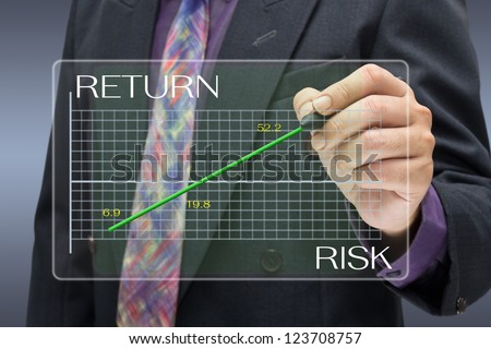 Businessman pointing on investment graph - stock photo