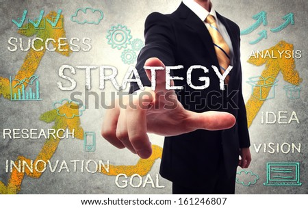 Businessman pointing STRATEGY with handwriting cartoon - stock photo