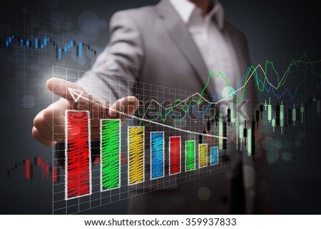 Businessman pointing to a growth chart showing business success - stock photo