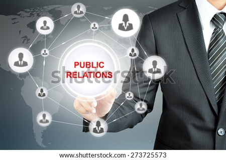 Businessman pointing to PUBLIC RELATIONS sign with businesspeople icon network on virtual screen - stock photo