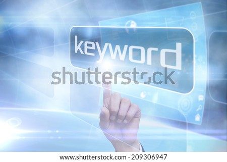 Businessman pointing to word keyword against futuristic technology interface - stock photo