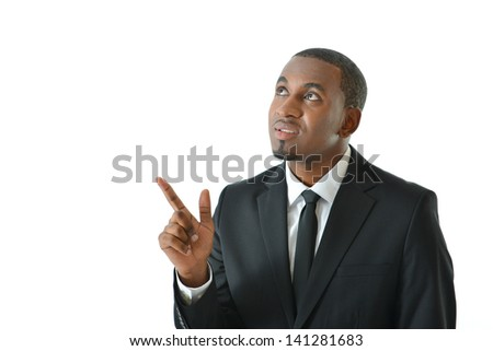 Businessman pointing upward thinking of ideas - stock photo