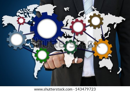 Businessman pointing world map with dynamic gear for international business cooperation - stock photo