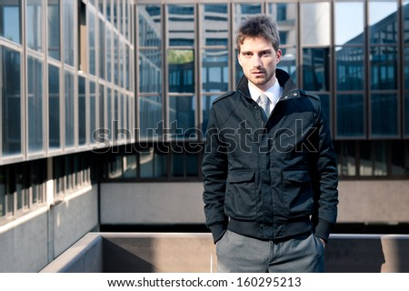 Businessman portrait with modern building as background.  - stock photo