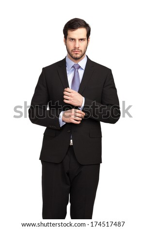 businessman posing in a black suit, isolated - stock photo