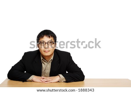 Businessman posing in an office, with copy space - stock photo