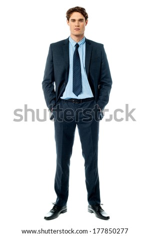 Businessman posing with hands in pocket on white background - stock photo