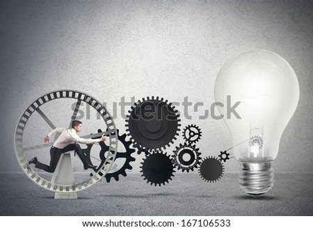 Businessman powering an idea with gear system - stock photo