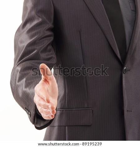 Businessman prepares for the handshake - stock photo
