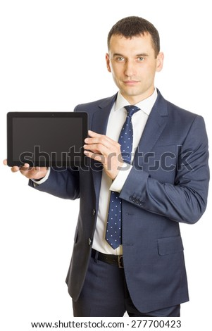 Businessman presenting a blank screen digital tablet - stock photo