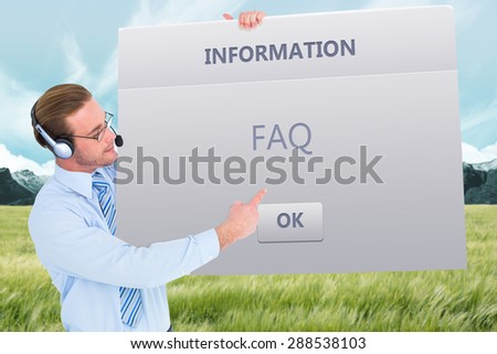 Businessman presenting card wearing headset against info box - stock photo