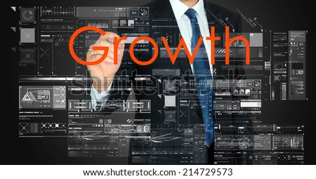 businessman presenting Growth text on business background  - stock photo