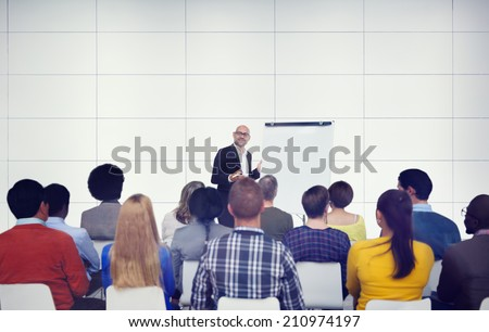 Businessman Presenting in Front of Audience - stock photo
