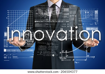 businessman presenting Innovation concept of his own hands:  - stock photo
