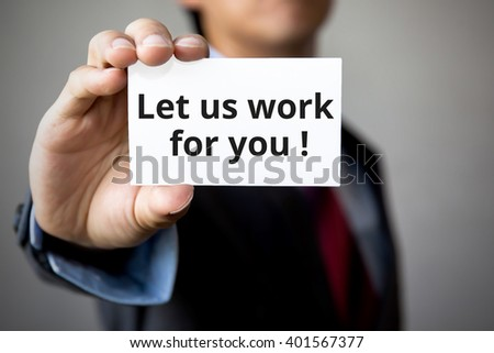 Businessman presenting 'Let us work for you'' word on white card - stock photo